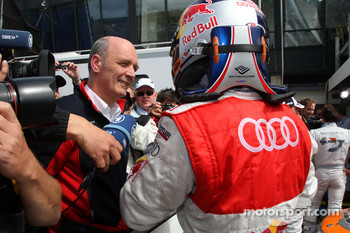 Dr Wolfgang Ullrich, Audi's Head of Sport talking to Mattias Ekström, Audi Sport Team Abt Audi A4 DTM
