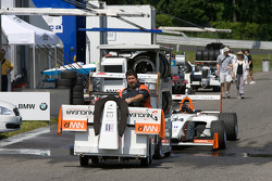 Teams get ready for the race in the paddock