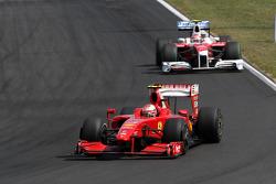 Kimi Raikkonen, Scuderia Ferrari, Timo Glock, Toyota F1 Team