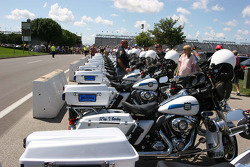 Indiana State Police motorcycles are lined up in the infield