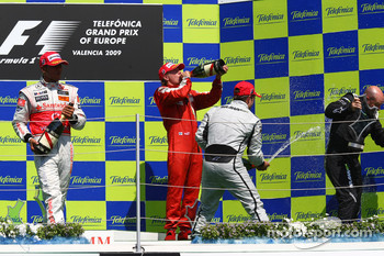Podium: champagne celebration for race winner Rubens Barrichello, BrawnGP, second place Lewis Hamilton, McLaren Mercedes, third place Kimi Raikkonen, Scuderia Ferrari