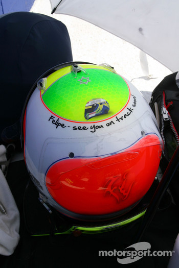 Rubens Barrichello, Brawn GP with an changed helmet design for his friend Felipe Massa, Scuderia Ferrari