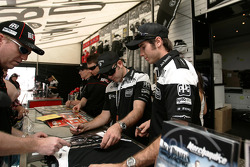 Todd Kelly and Rick Kelly signing autographs
