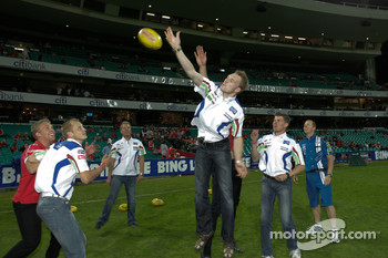 BP Ford Abu Dhabi World Rally Team drivers Mikko Hirvonen, Jarmo Lehtinen, Jari-Matti Latvala, Miikka Anttila and V8 Supercar driver Steve Richards dropped in at the Sydney Swans V Brisbane Lions game at the SCG