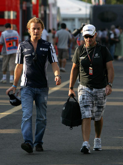 Nico Rosberg, Williams F1 Team and Rubens Barrichello, Brawn GP