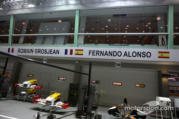 The Renault F1 Team garage is closed while a meeting happens inside