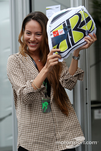 Jessica Michibata, girlfriend of Jenson Button, BrawnGP, with a cushion in the shape of Jenson's helmet