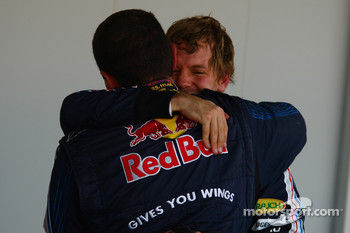 Race winner Sebastian Vettel, Red Bull Racing hugs Guillaume Rocquelin, Red Bull Racing Race Engineer of Sebastian Vettel