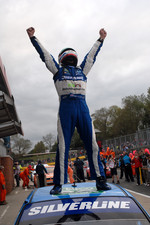 Jason Plato celebrates his hat-trick victory