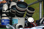 Photographers try to dry their lenses