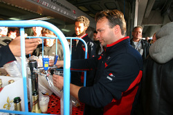 The Abt team handong out free beer and champagne in the pits with a mobile bar