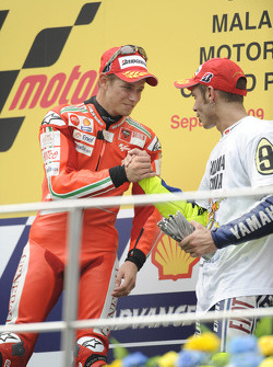 Podium: race winner Casey Stoner, Ducati Marlboro Team with third place and 2009 MotoGP champion Valentino Rossi, Fiat Yamaha Team