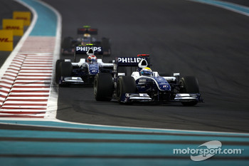 Nico Rosberg, WilliamsF1 Team leads Kazuki Nakajima, Williams F1 Team