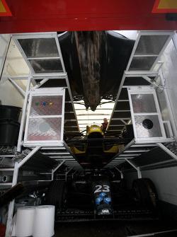 F2 Mechanics load the cars into the trucks