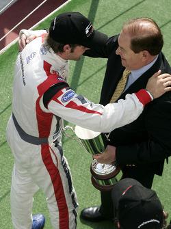 Race winner Andy Soucek celebrates on the podium