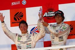 GT300 Championship podium: second place #7 M7 Mutiara Motors Amemiya SGC-7: Nobuteru Tanigichi, Ryo Orime
