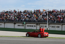 Luca di Montezemolo drives Felipe Massa and Fernando Alonso around the track in a Ferrari California: so far, so good