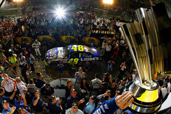 Championship victory lane: 2009 and 4th time NASCAR Sprint Cup Series champion Jimmie Johnson hoists the Sprint Cup trophy