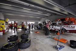 Teams prepare in the garage