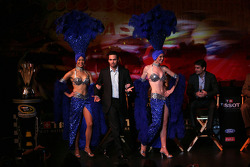 Las Vegas showgirls escort four-time NASCAR Sprint Cup Champion Jimmie Johnson onstage during Thursday's NASCAR After The Lap event at the Hollywood Theatre at the MGM Grand Hotel