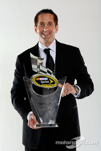 Greg Biffle with his award for seventh place in the Chase for the NASCAR Sprint Cup