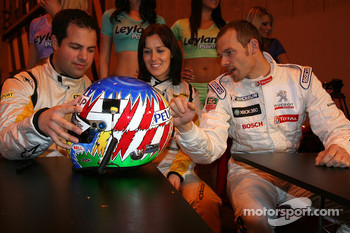 BBC presenters Ted Kravitz and Lea Mckenzie check out Alex Wurz new helmet Design