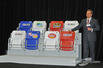 CMS track president and general manager Marcus Smith unveils new and wider seats to be installed on the speedway's frontstretch