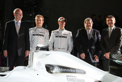 Dr. Dieter Zetsche, Nico Rosberg, Michael Schumacher, Norbert Haug and  Nick Fry pose with the 2009 Brawn GP car with the 2010 livery