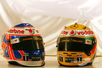 Jenson Button, McLaren Mercedes and Lewis Hamilton, McLaren Mercedes helmets
