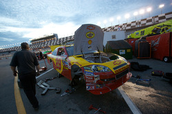 Richard Childress Racing Chevrolet crew members work on the wrecked car of Kevin Harvick