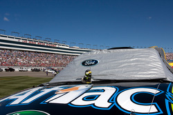 The No. 99 Aflac car sits on pit road
