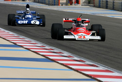 1976 McLaren M23 and Sir Jackie Stewart, 1969, 1971, 1973 F1 World Champion drives the 1973 Tyrrell-Ford 006