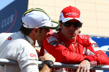 Jarno Trulli, Lotus F1 Team and Fernando Alonso, Scuderia Ferrari