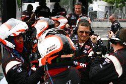 Team Penske team members celebrate Will Power's win