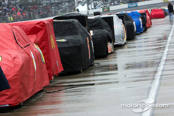 Cars are lined up on pit road during the rain delay