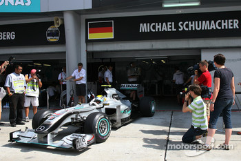 Nico Rosberg, Mercedes GP leaving from the incorrectly labeled garage of Michael Schumacher, Mercedes GP