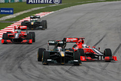 Jarno Trulli, Lotus F1 Team, Timo Glock, Virgin Racing