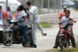 Michael Schumacher, Mercedes GP, stops on the circuit because of a wheel technical problem