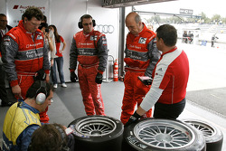 Dr. Wolfgang Ullrich inspects the tires