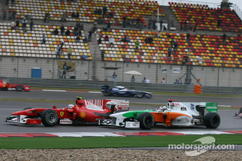 Fernando Alonso, Scuderia Ferrari and Adrian Sutil, Force India F1 Team