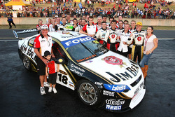 James Courtney celebrates with his team after taking out race 9 of the 2010 V8 Supercar Championship
