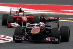 Sebastien Buemi, Scuderia Toro Rosso leads Fernando Alonso, Scuderia Ferrari