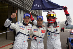 Race winners Sébastien Bourdais, Pedro Lamy and Simon Pagenaud celebrate