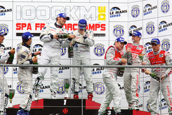 LMP1 podium: class and overall winners Pedro Lamy, Sébastien Bourdais and Simon Pagenaud, second place Franck Montagny, Stéphane Sarrazin and Nicolas Minassian, third place Rinaldo Capello, Tom Kristensen and Allan McNish celebrate with champagne