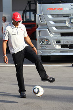 Lewis Hamilton, McLaren Mercedes playing football in the paddock