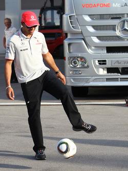 Lewis Hamilton, McLaren Mercedes playing football in the paddock