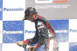 Rio Haryanto celebrates victory on the podium