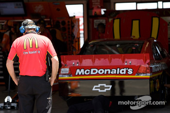 A crew member looks over the No. 1 McDonald's car