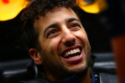 Daniel Ricciardo, Red Bull Racing smiles as he sits in his car in the garage