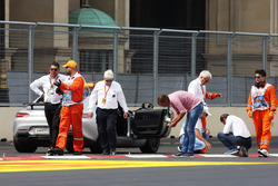 Charlie Whiting, FIA Delegate and Herbie Blash, FIA Delegate inspect the circuit after GP2 qualifying is postponed